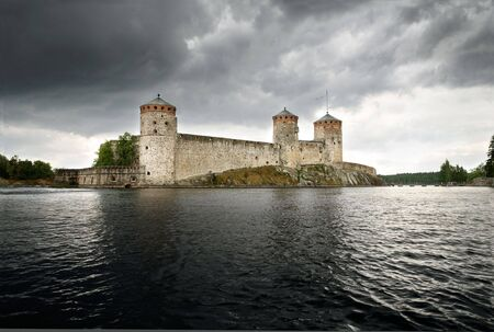 Olavinlinna medieval castle in eastern Finland in the city of Savonlinna photo