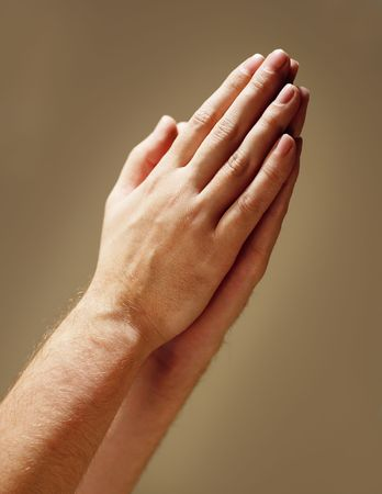 hands praying: Hands clasped in prayer