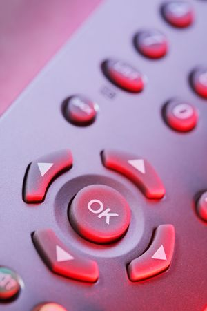 digital television: Digital television remote control buttons in red light. Stock Photo