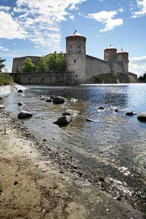 Olavinlinna medieval castle in eastern Finland in the city of Savonlinna Olavinlinna Castle was founded in 1475 to secure the eastern border of the Kingdom of Sweden Finland photo