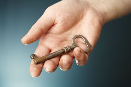 A Hand holding an old key. Stock Photo - 3435937