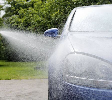 water hose: Spraying a car with a water hose
