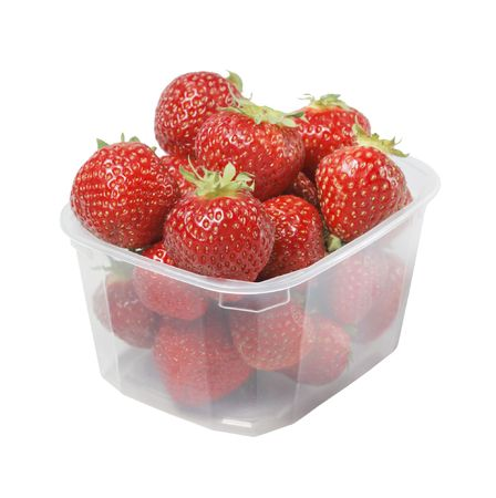 Strawberries in a small plastic cup isolated on white photo