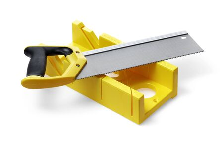 miter: A yellow miter box and a backsaw on white