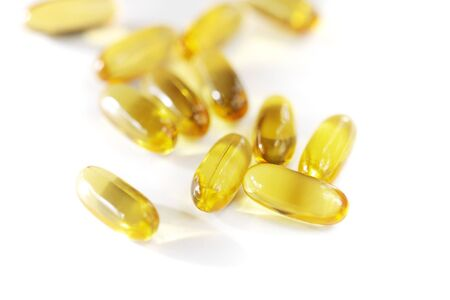 Omega 3 fish oil capsules on white Stock Photo - 3953430