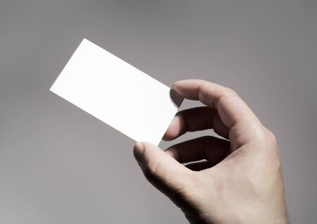 Hand holding a blank business card Stock Photo - 3953434