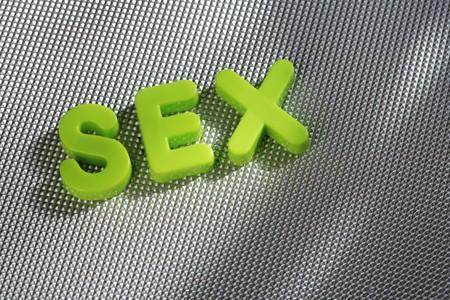 Palabra SEXO escribe con letras de plástico verde Foto de archivo - 4069092