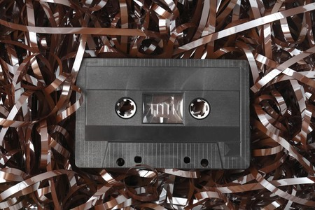 Old black audio C-cassette and tangled tape Stock Photo - 4069089