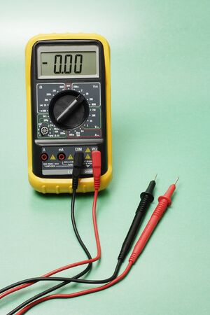 probes: Digital multimeter with probes on green background