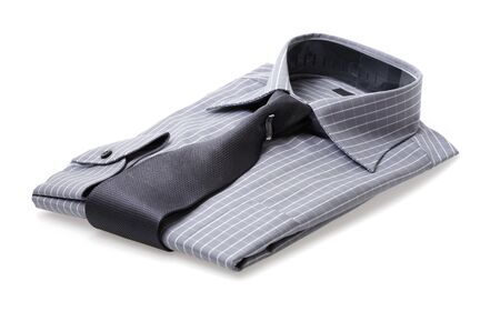 A Plaid shirt with a silk tie folded neatly photo