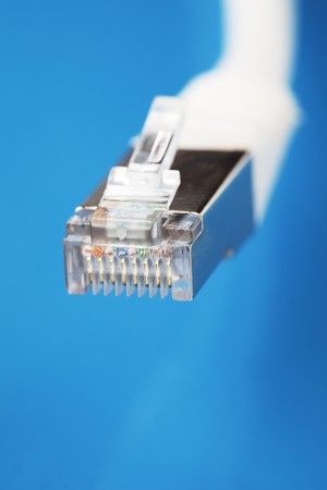 White shielded cat5 cable on blue Stock Photo - 4247726