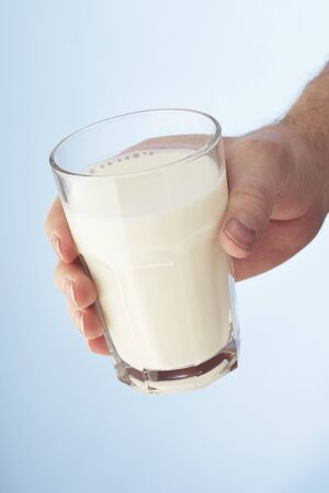 A Hand holding a glass of milk Stock Photo - 4247684