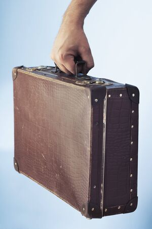 Hand carrying an old suitcase Stock Photo - 4247693