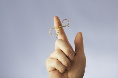 A string tied around an index finger photo