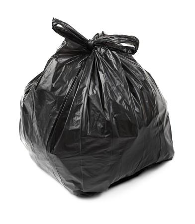 black plastic garbage bag: Black plastic trash bag on white