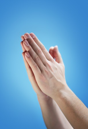 praying together: Hands clasped together for a prayer