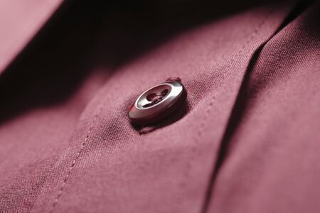 Button of a dark red new shirt Stock Photo - 4408022