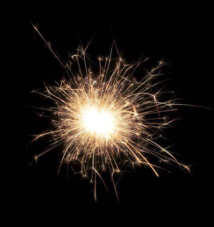 Sparks from a sparkler on black
