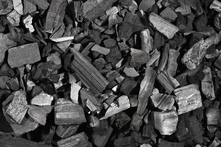 Texture de fond de morceaux de charbon de bois noir