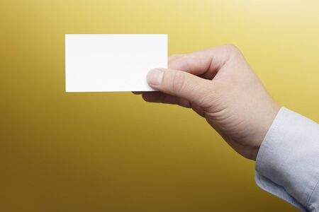 Hand holding a blank business card Stock Photo - 4592811