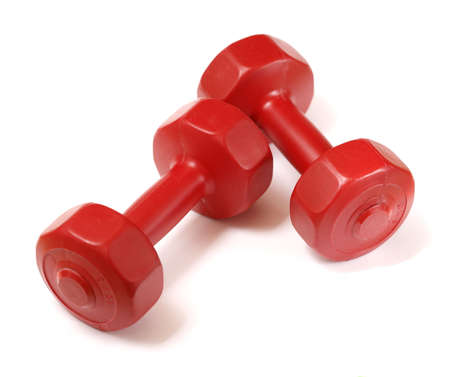 Small red 1,5kg (3 lbs.) plastic dumbells on white