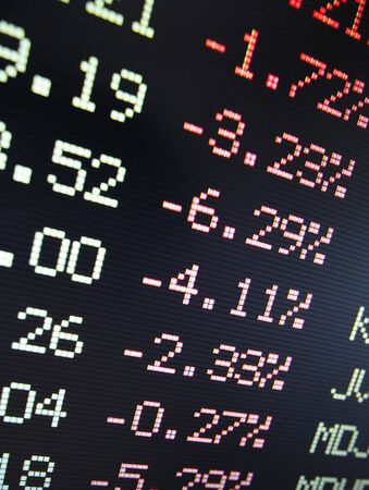 by the lcd screen: Negative financial stock data on a lcd screen