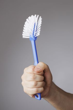 A Hand holding a blue dish brush Stock Photo - 4766812