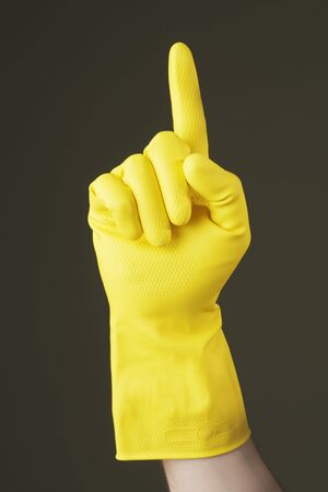 A Hand with yellow protective rubber glove pointing with index finger Stock Photo - 4766722