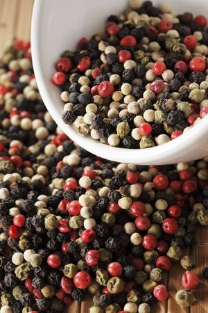 A mix of black, green, red and white peppercorns. photo