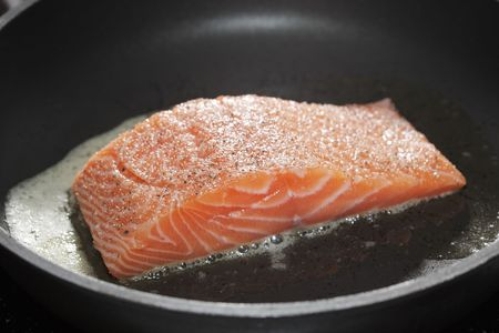 Salmon fillet on a frying pan photo