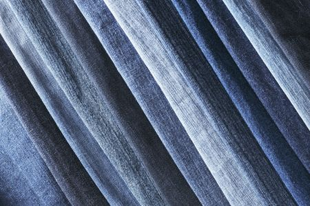 nuances: Different shades of blue jeans denim fabrics. Stock Photo