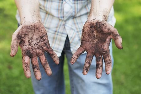 A Man showing dirty hands after gardening work