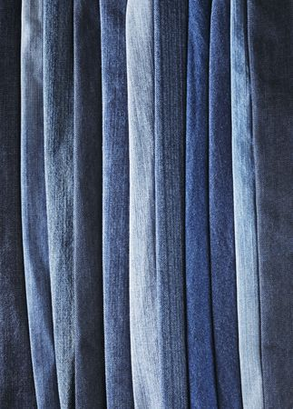 nuances: Different shades of blue jeans denim fabrics. Stock Photo
