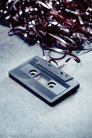 trashed: Old trashed audio c cassette. Short depth of field.