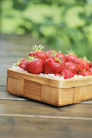 Fresh strawberries in a small wooden basket Stock Photo - 5279711