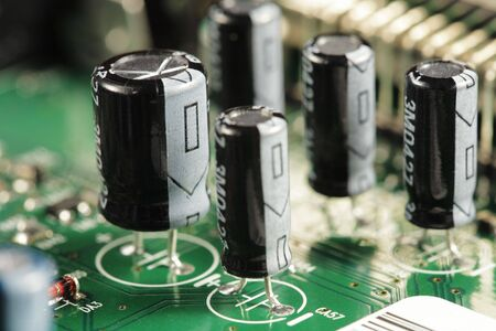 capacitor: Capacitor electrical components on a circuit board