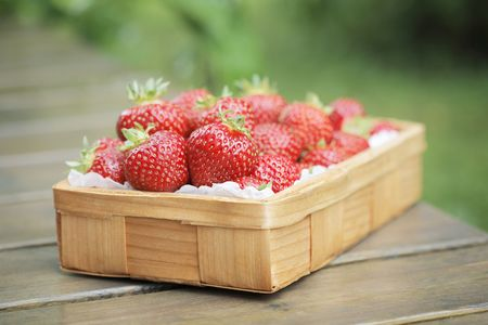 Fresh strawberries in a small wooden basket Stock Photo - 5454502
