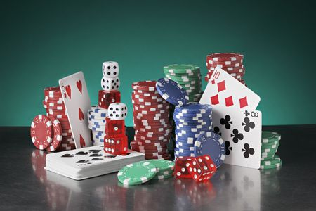 Still life with poker chips, playing cards and dice.