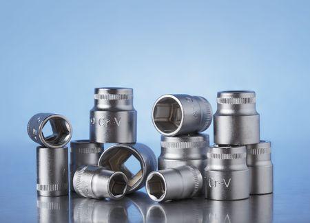 ratchet: Chrome Vanadium metric Ratchet sockets on reflecting metal surface
