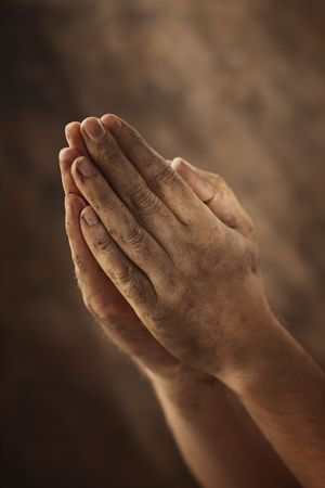 dirty man: Dirty hands clasped together for a prayer Stock Photo