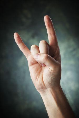 cuernos: Una mano haciendo un signo de los cuernos de diablo signo alias alias maloik