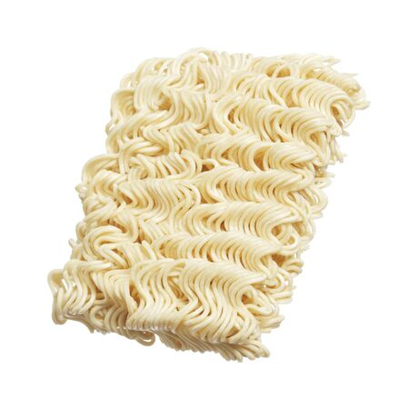 instant ramen: A block of dry instant ramen noodles isolated on white Stock Photo