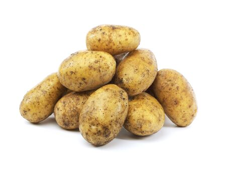 A Heap of harvested dirty potatoes on white