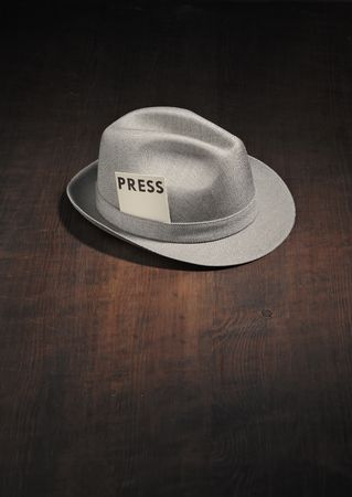 Vintage trilby hat with a press card