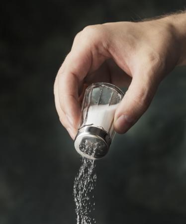 seasonings: Hand adding salt using a salt shaker