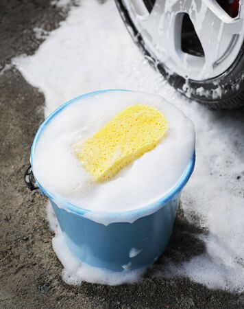 soapy: Bucket with soapy water, a sponge and a car wheel.