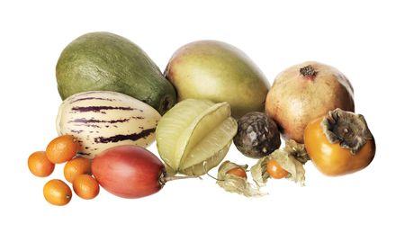 pepino: Various exotic fruit isolated on white. Papaya, mango, pomegranate, pepino, carambola, passion fruit, sharonkakipersimmon, kumquat, tamarillo, physalis
