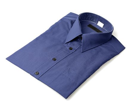 in men's shirt: Mens blue buttoned dress shirt isolated on white with natural shadows.
