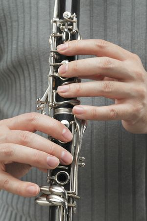 woodwind: Man playing Clarinet, a woodwind instrument.