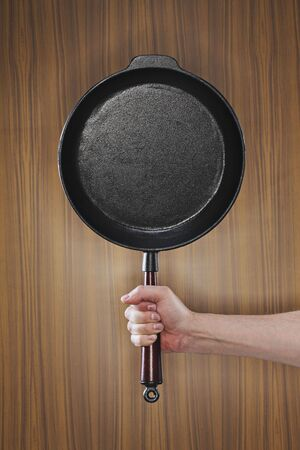 An old-fashioned cast iron frying pan photo